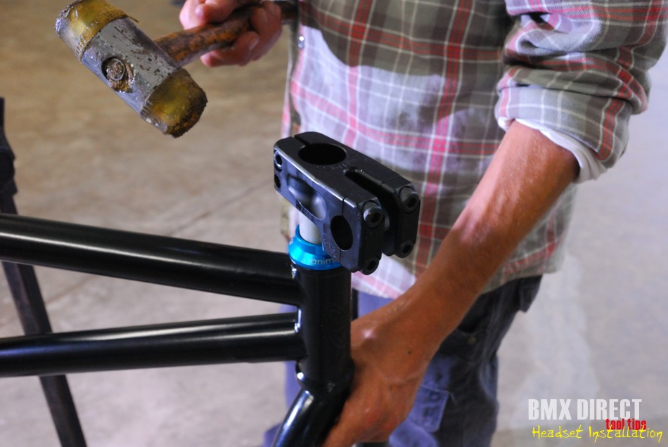 With new parts some minor force may be needed to get the stem on to the fork. Use a rubber mallet to tap it down gently. Check that the bearing in the bottom is sitting nicely in the frame before tightening your bolts.