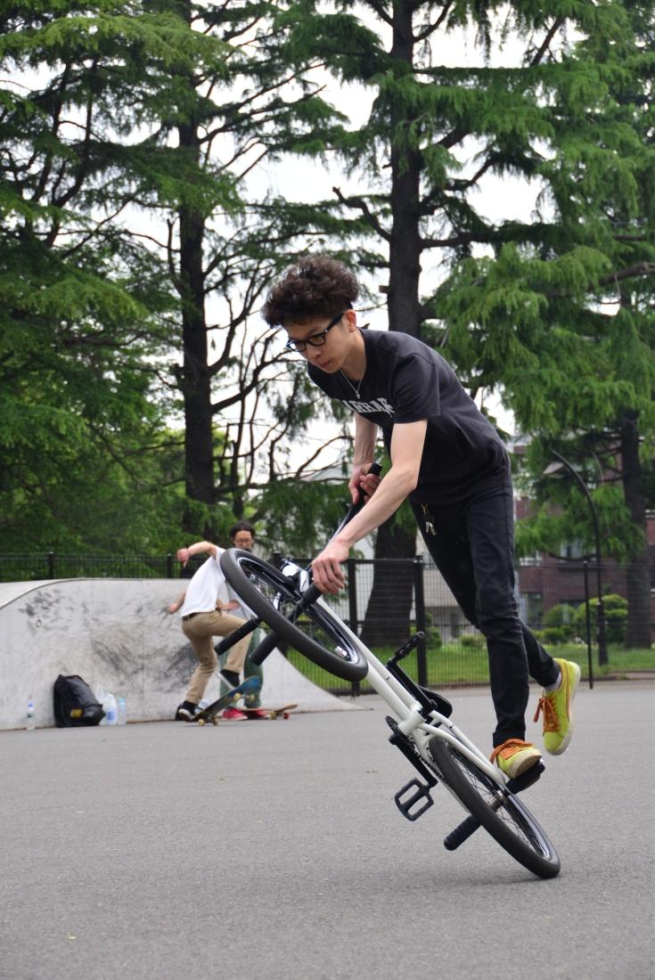 Atushi, BMX shop owner and rider, shreds on the back wheel! Komawaza Park.