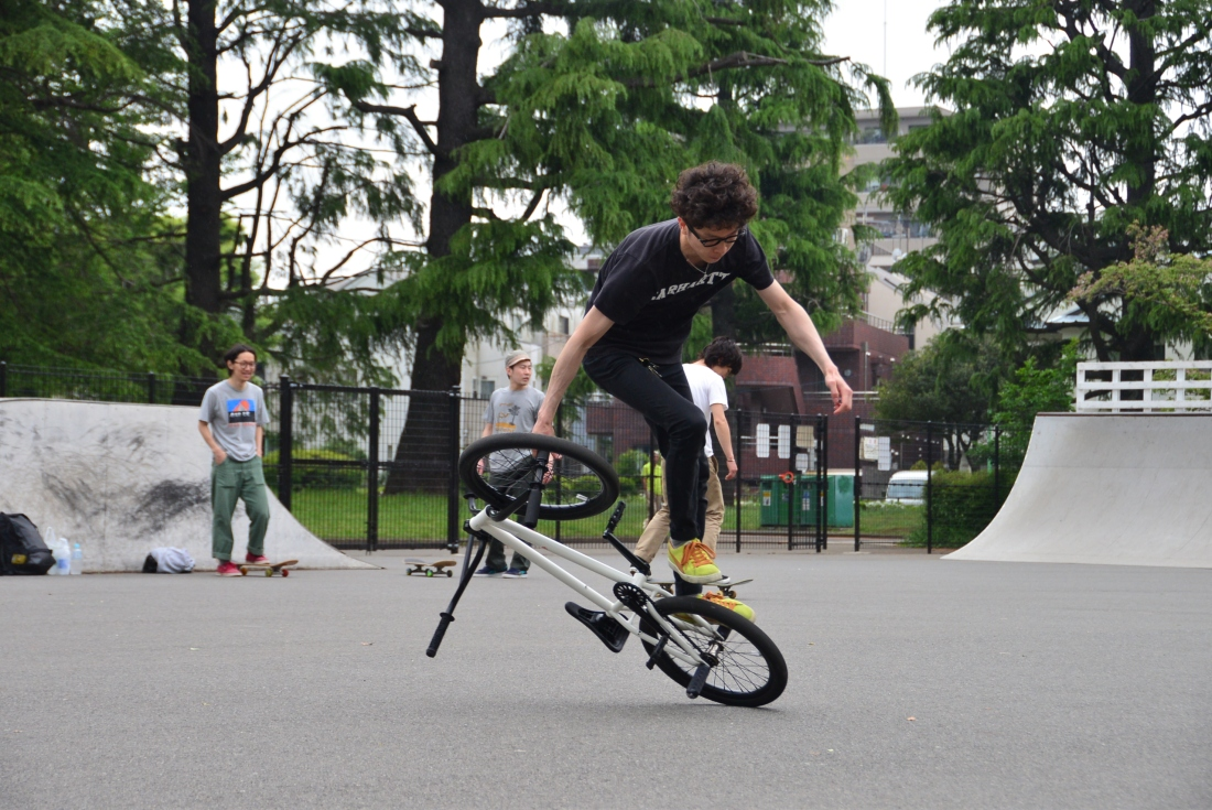 Atushi, BMX shop owner and rider, shreds on the back wheel! Komawaza Park.