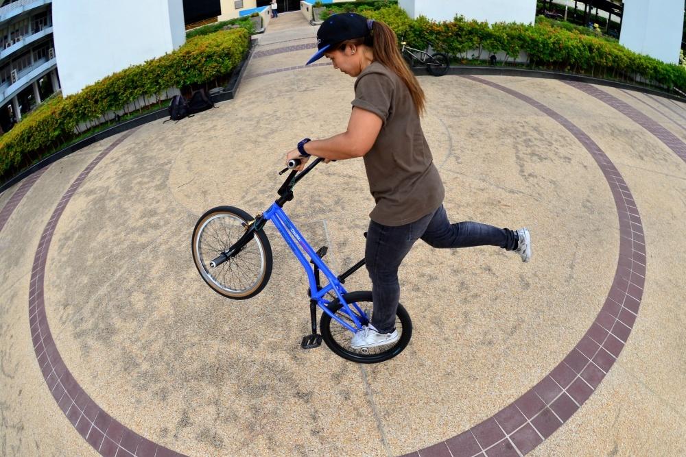 """""""A"""" Girl rider from Bangkok. Peg wheelie."""